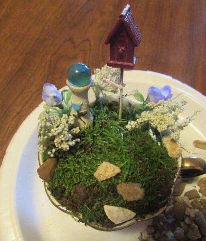 mini fairy garden in a tea cup