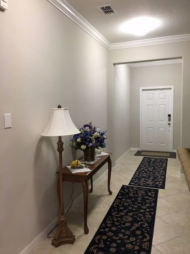 q how can i decorate a hall way to incorporate it into the room