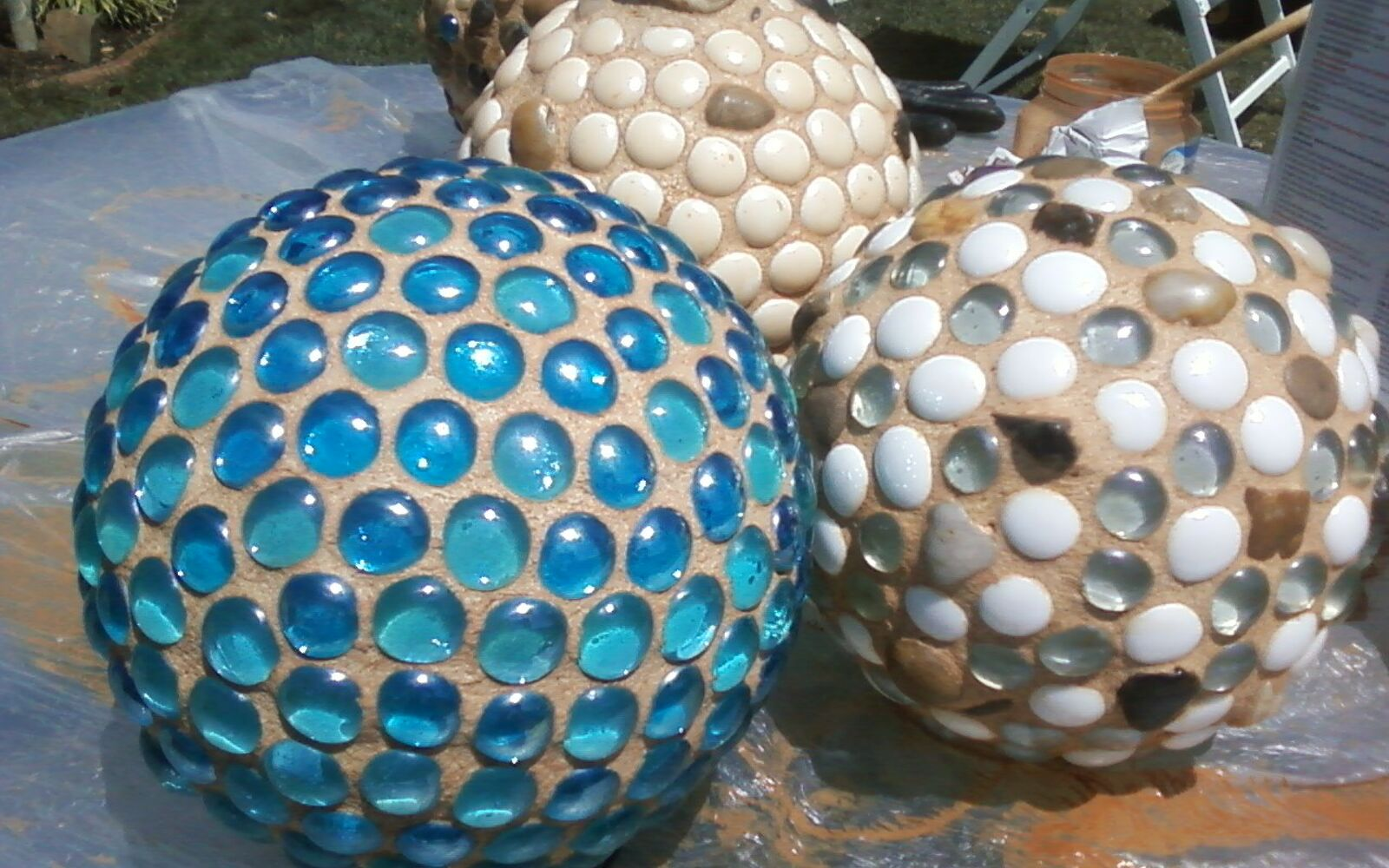 s 30 ways for you to style your garden, Bedazzle Globes As Garden Centerpieces