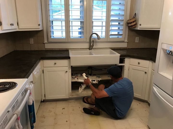 My husband putting in new sink