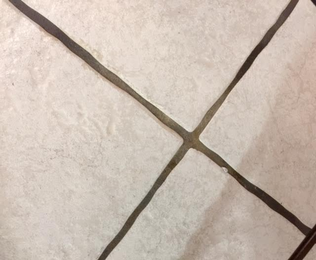 q dirty grout in kitchen