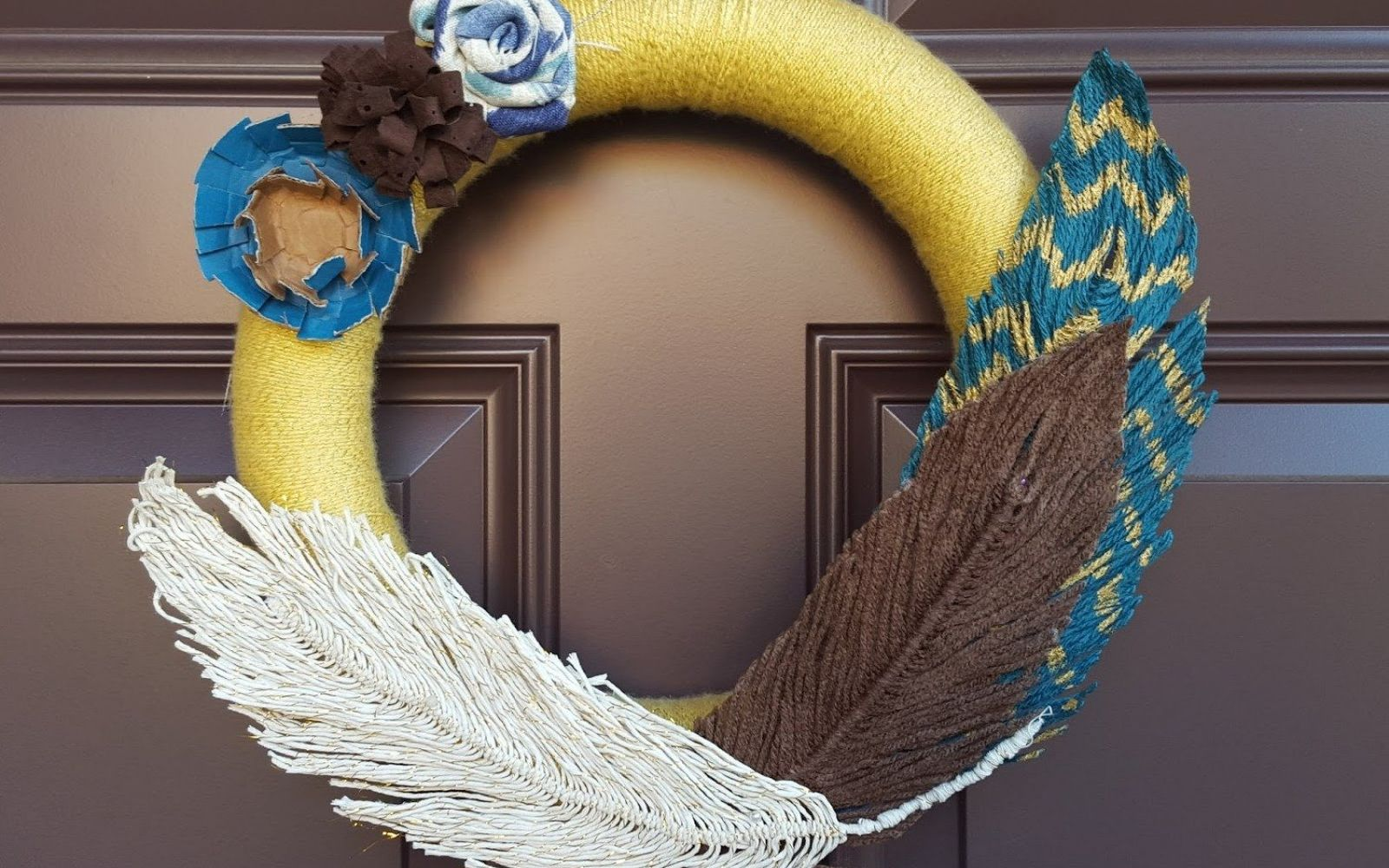 s 17 tricks to make a gorgeous wreath in half the time, Place Yarn Feathers Into Your Wreath