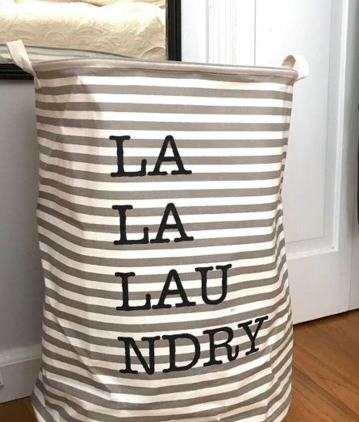 s 10 super simple ways to upcycle items in your home for storage, Build A Rolling Laundry Basket With A Barrel