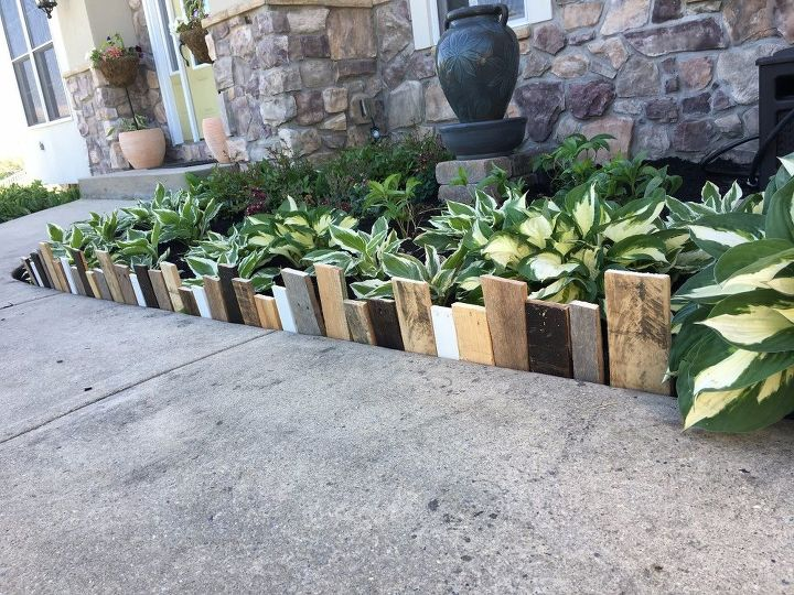 s 10 wonderful ways to use pallets and the results are beautiful, Hammer Down Pallet Pieces For A Garden Border