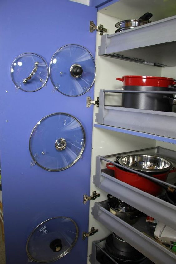 s 10 fun space saving hacks to keep you clutter free, Use A Command Hook To Wrangle In Pot Lids