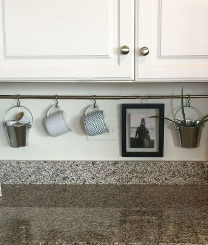 s 10 fun space saving hacks to keep you clutter free, Arrange Kitchenware On A Curtain Rod