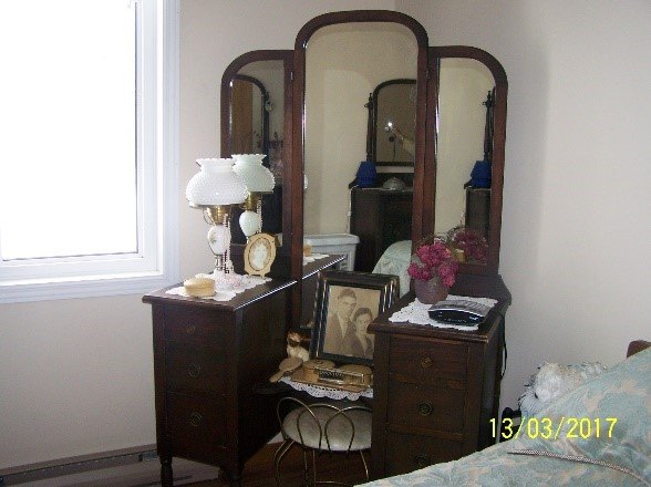 q how to clean up an antique dresser