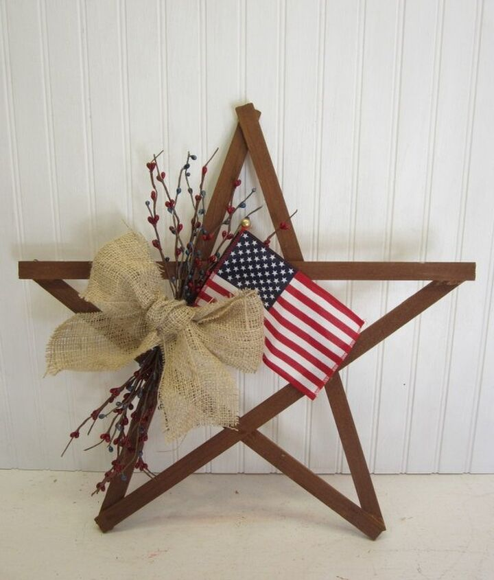 s 15 unusual flag ideas that actually look amazing, Stick The Flag In A Scrap Wood Wreath