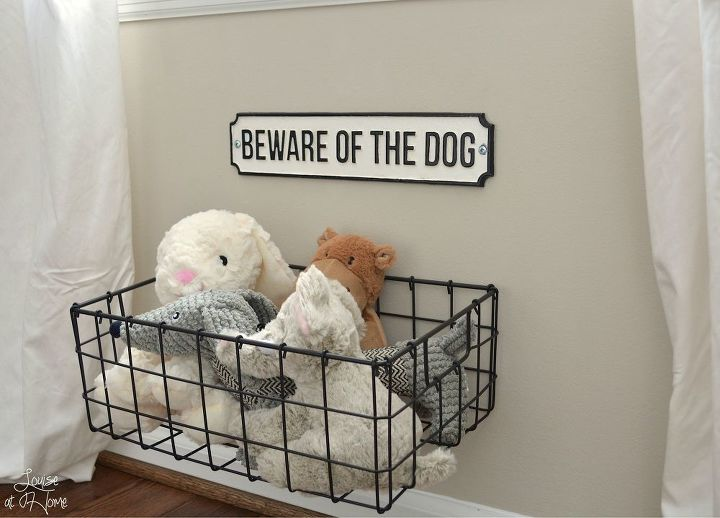 s 30 fun ways to keep your home organized, Organize Your Dog s Toys With A Basket