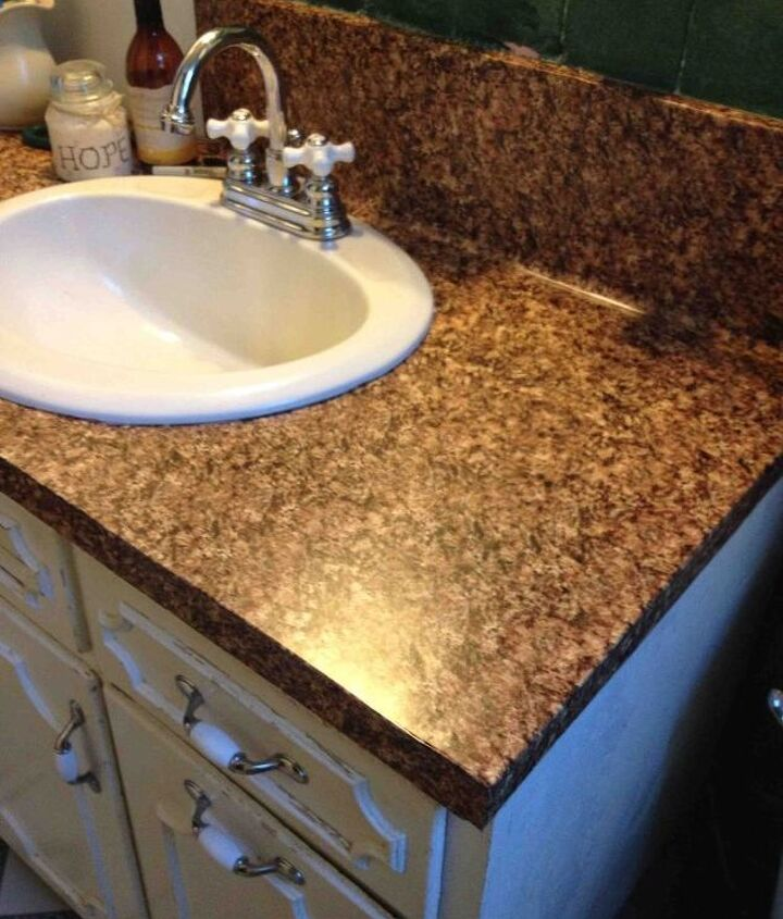 s 31 astounding things you didn t know you could do with contact paper, Turn your plastic vanity into granite