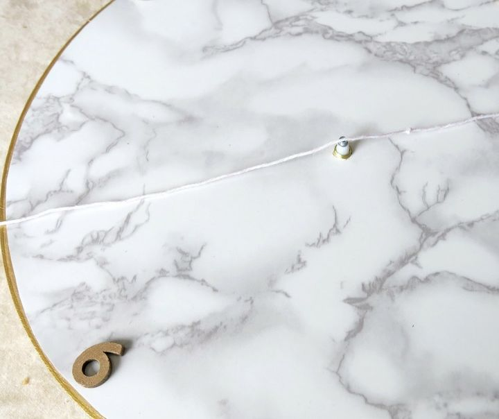 s 31 astounding things you didn t know you could do with contact paper, Create a marble contact paper clock