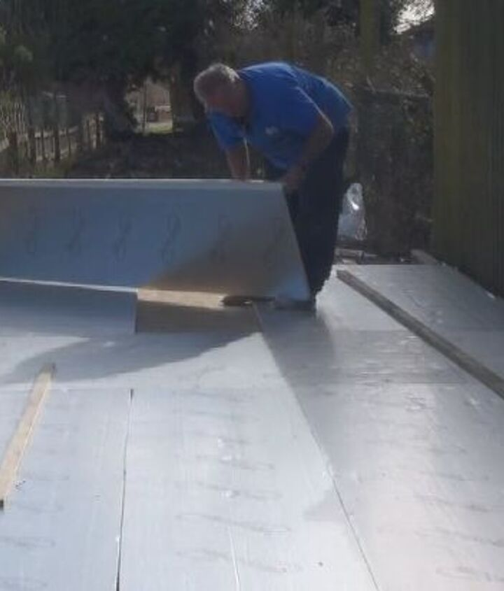 laying a wooden base for a large shed or workshop