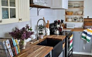budget kitchen reno featuring a stunning black farmhouse sink