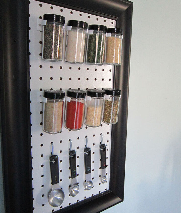 s 15 organizing hacks to help clean up your kitchen, Clamp Your Spices In A Peg Board Rack