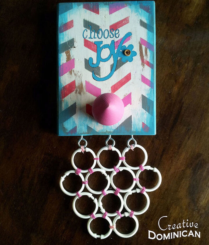 s 23 surprising uses for curtain rings, Tie a few rings together for a cute organizer
