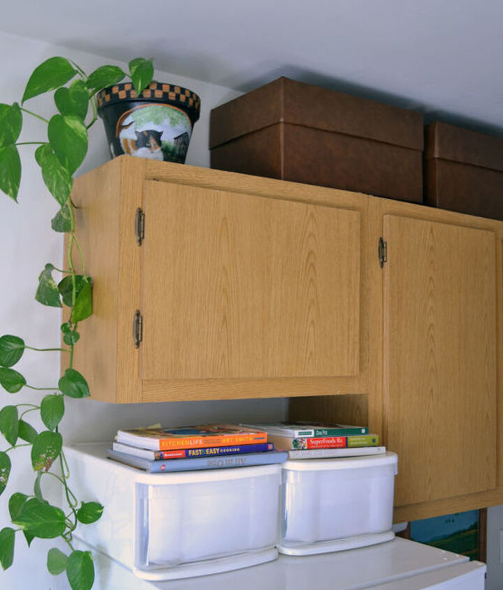 s space saving storage ideas that ll make your house feel much bigger, Fill the space above your cabinets with boxes