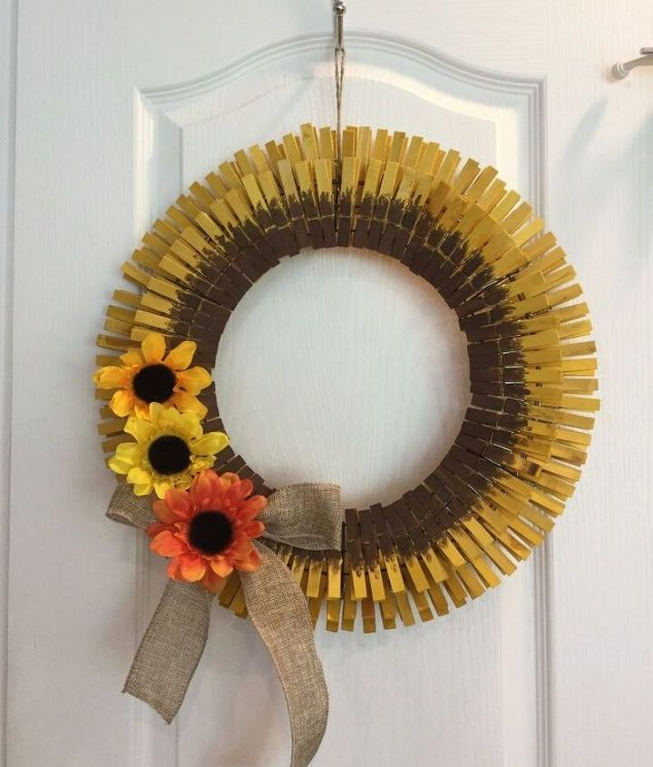 s 31 fabulous wreath ideas that will make your neighbors smile, Make a sunflower from clothespins