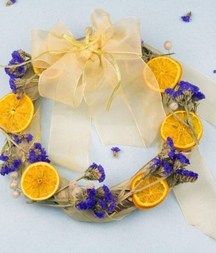 s 31 fabulous wreath ideas that will make your neighbors smile, Replace Fake Flowers With Dried Flowers