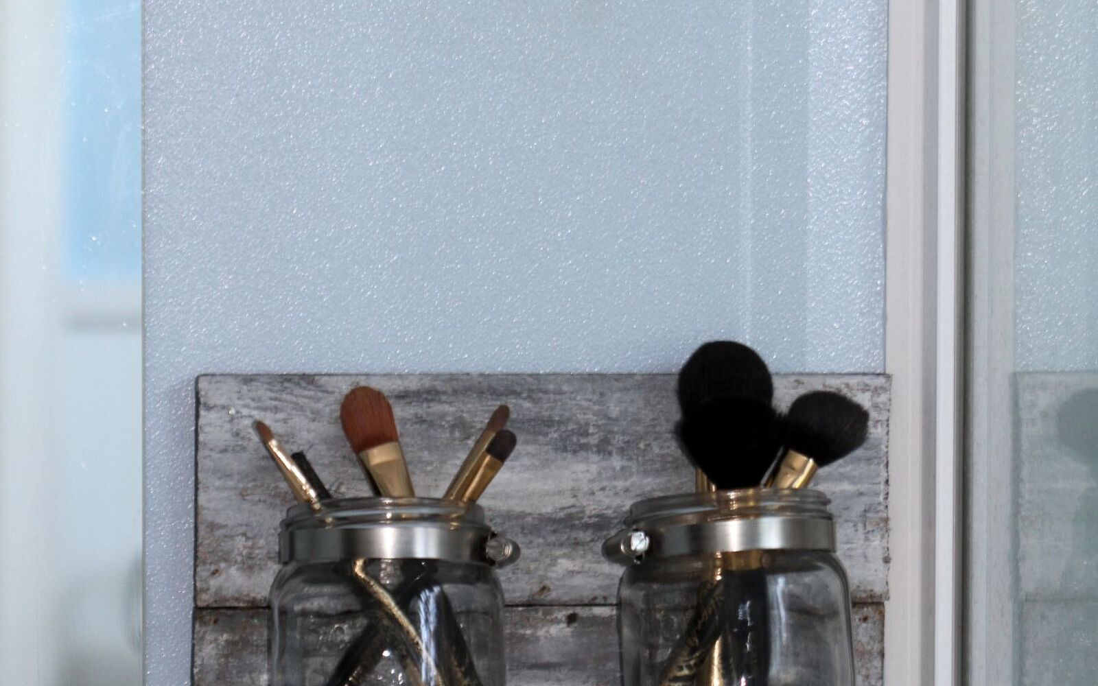 s 30 great mason jar ideas you have to try, Cool Clear Makeup Brush Organizer