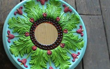 repurposed medallion into pretty mirror