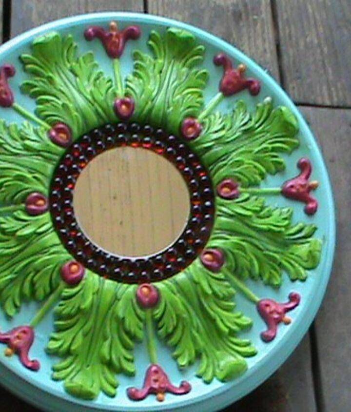 repurposed medallion into pretty mirror
