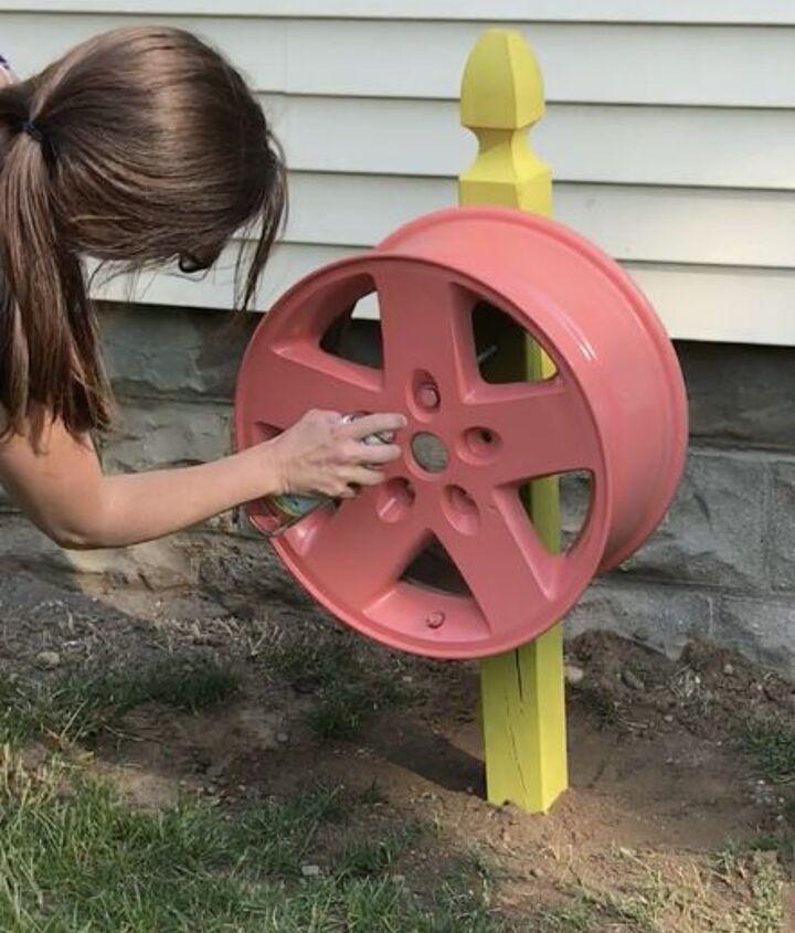 tire rim water hose holder
