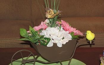make a floral centerpiece with fake flowers