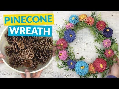 s 10 wreath ideas to brighten up your front door, Paint Pinecones In Pretty Pastels