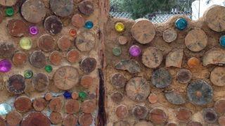 , caly walls w logs bottles