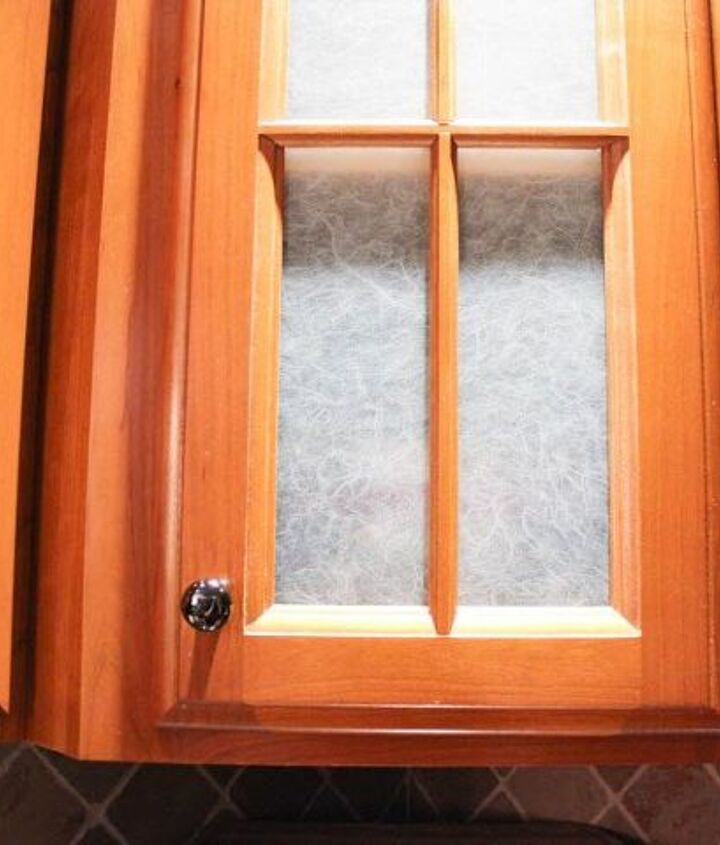 s 31 update ideas to make your kitchen look fabulous, Cover the glass doors with window film