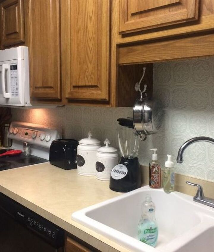 s 31 update ideas to make your kitchen look fabulous, Use textured wallpaper for a cool backsplash