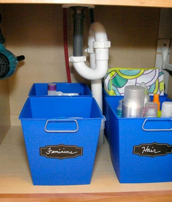 s 33 space saving storage ideas that ll keep your home organized, Organize your under the sink with bins