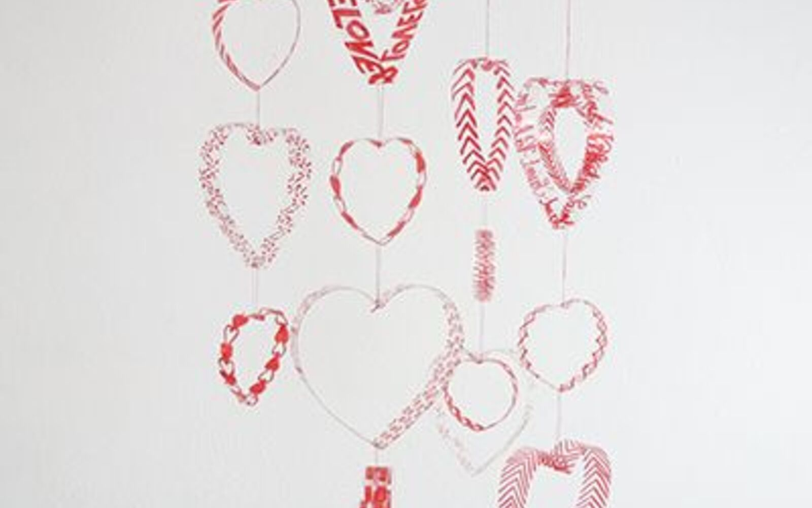s 30 useful ways to reuse plastic bottles, Make them into a gorgeous heart mobile