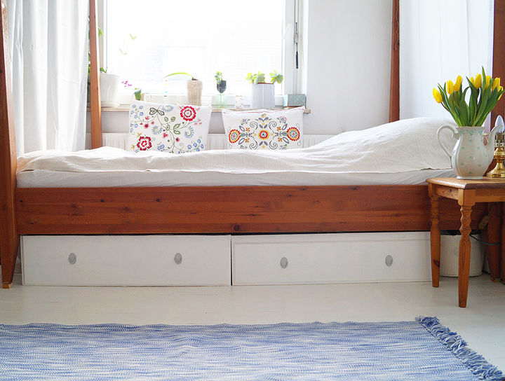 s 32 space saving storage ideas that ll keep your home organized, Put drawers underneath your bed