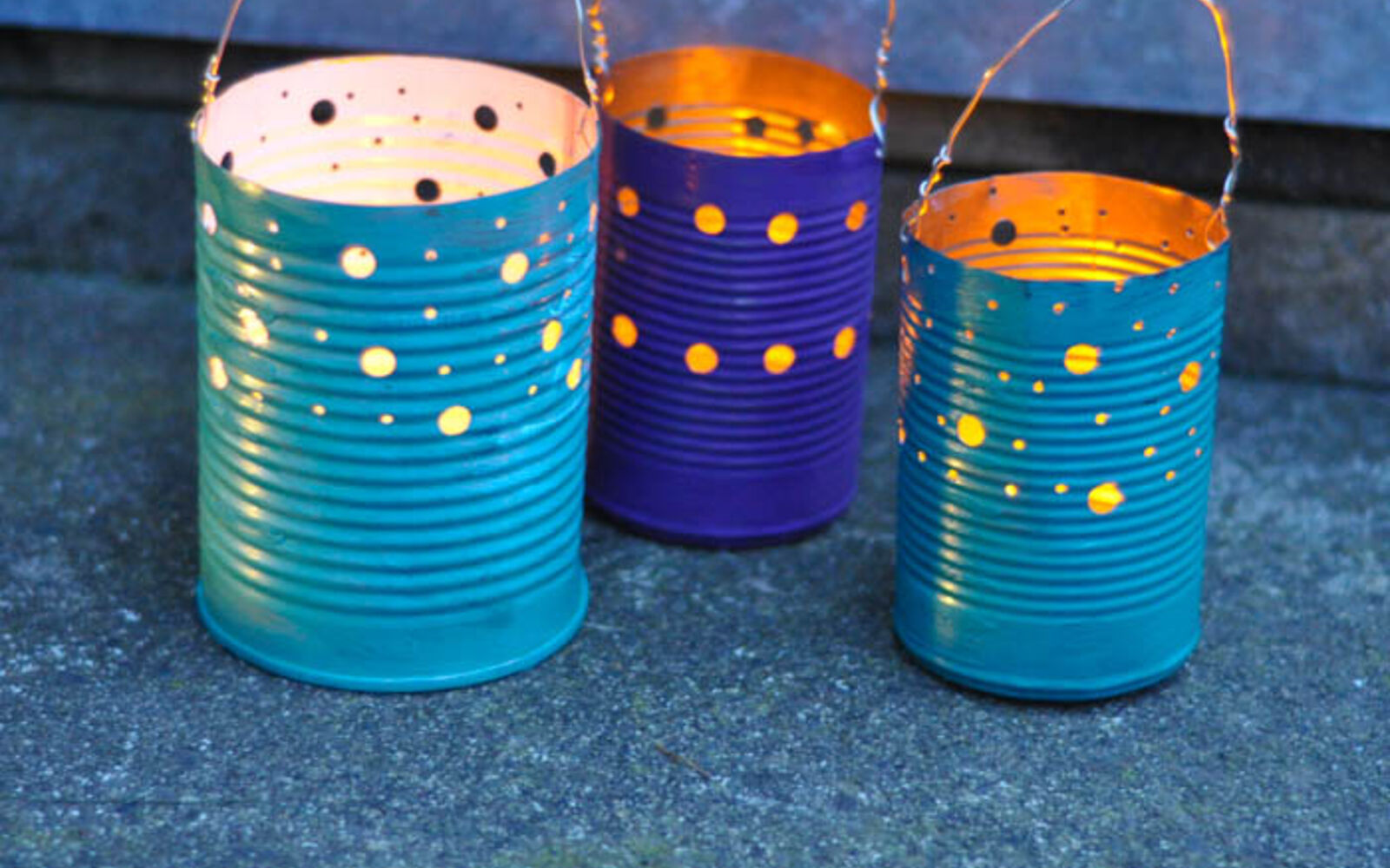 s save your old cans for these 30 home decor ideas, Hang them on trees for a nice ambience