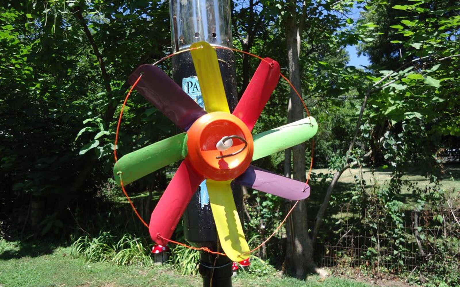 s save your old cans for these 30 home decor ideas, Turn them into colorful wind spinners