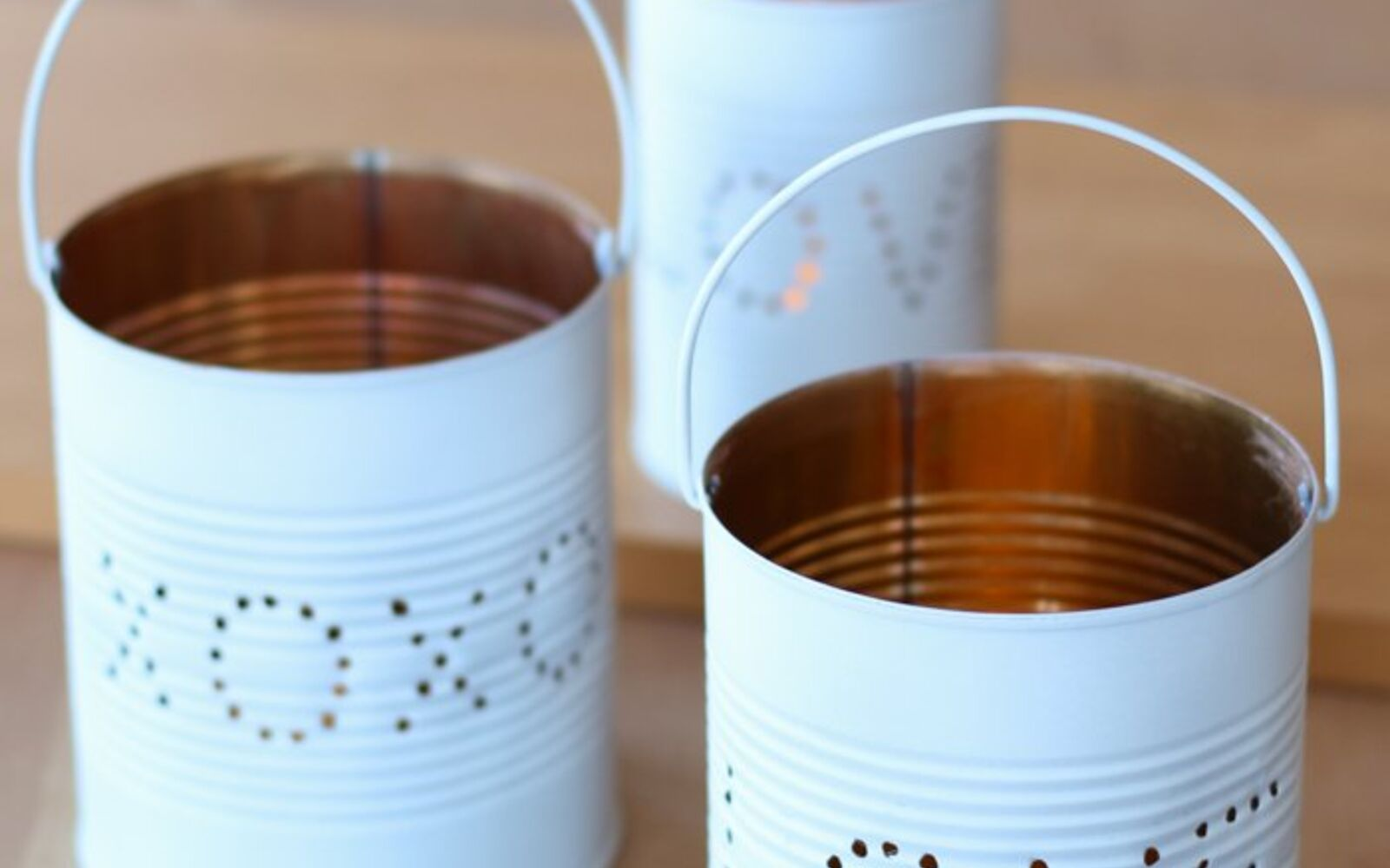 s save your old cans for these 30 home decor ideas, Spread the love with this cute lantern idea