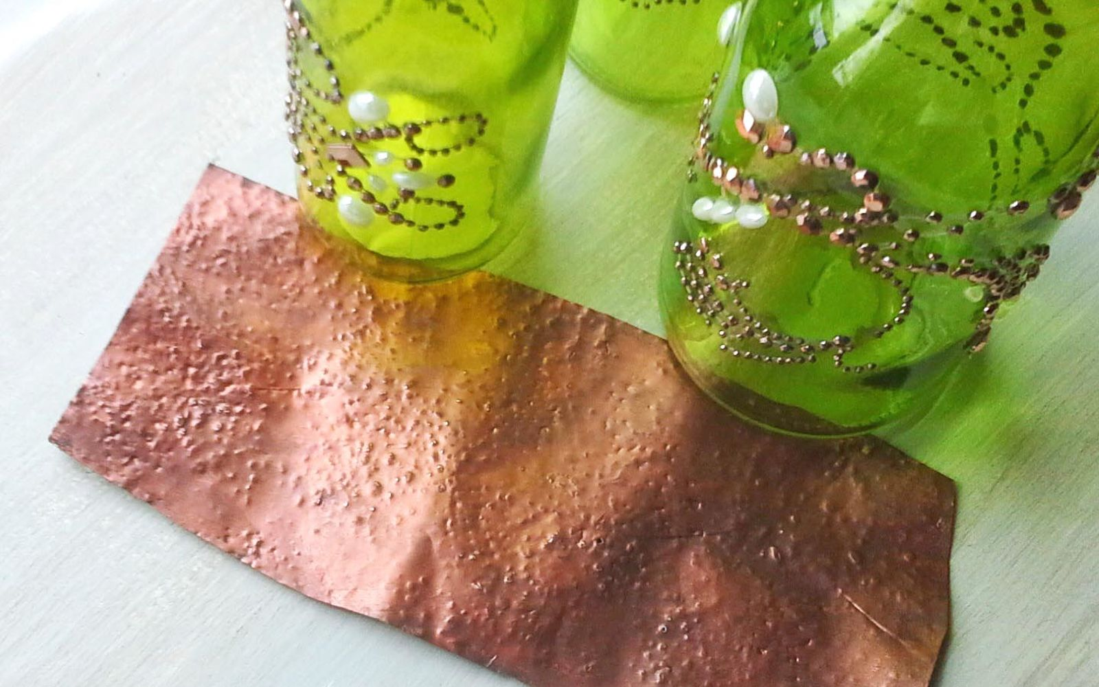 s save your old cans for these 30 home decor ideas, Use them to get a hammered copper texture
