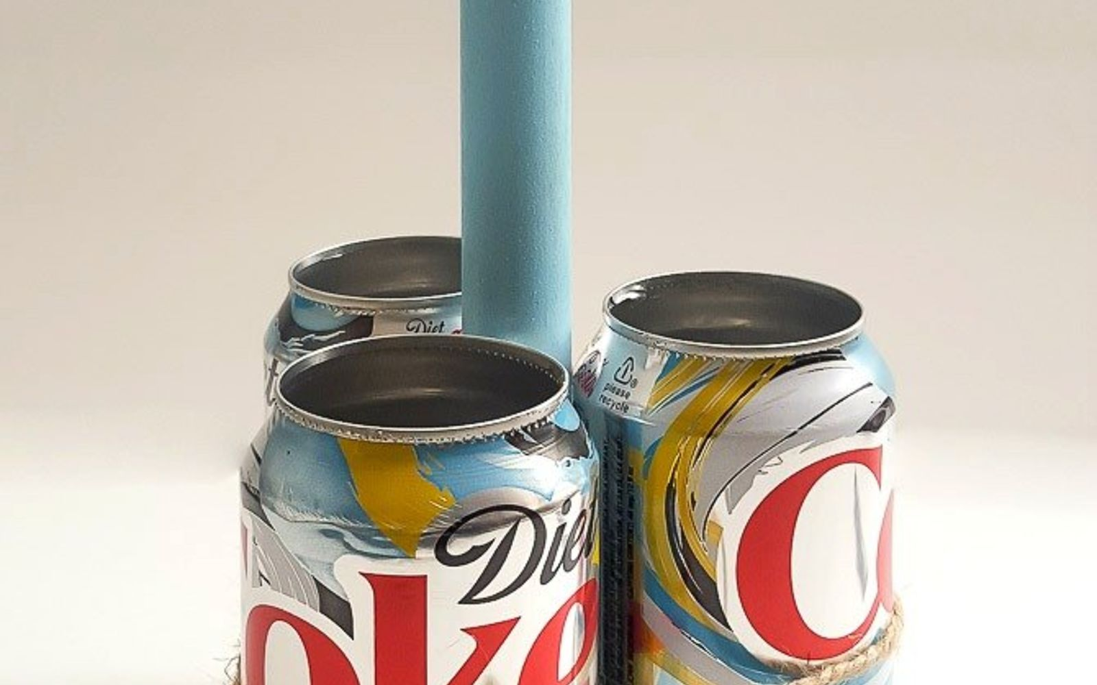 s save your old cans for these 30 home decor ideas, Upcycle them into a crafty caddy