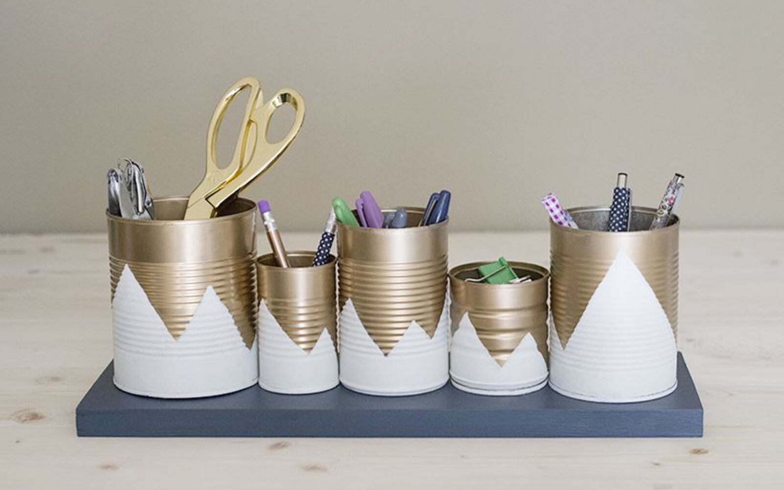 s save your old cans for these 30 home decor ideas, Glue together a desk organizer
