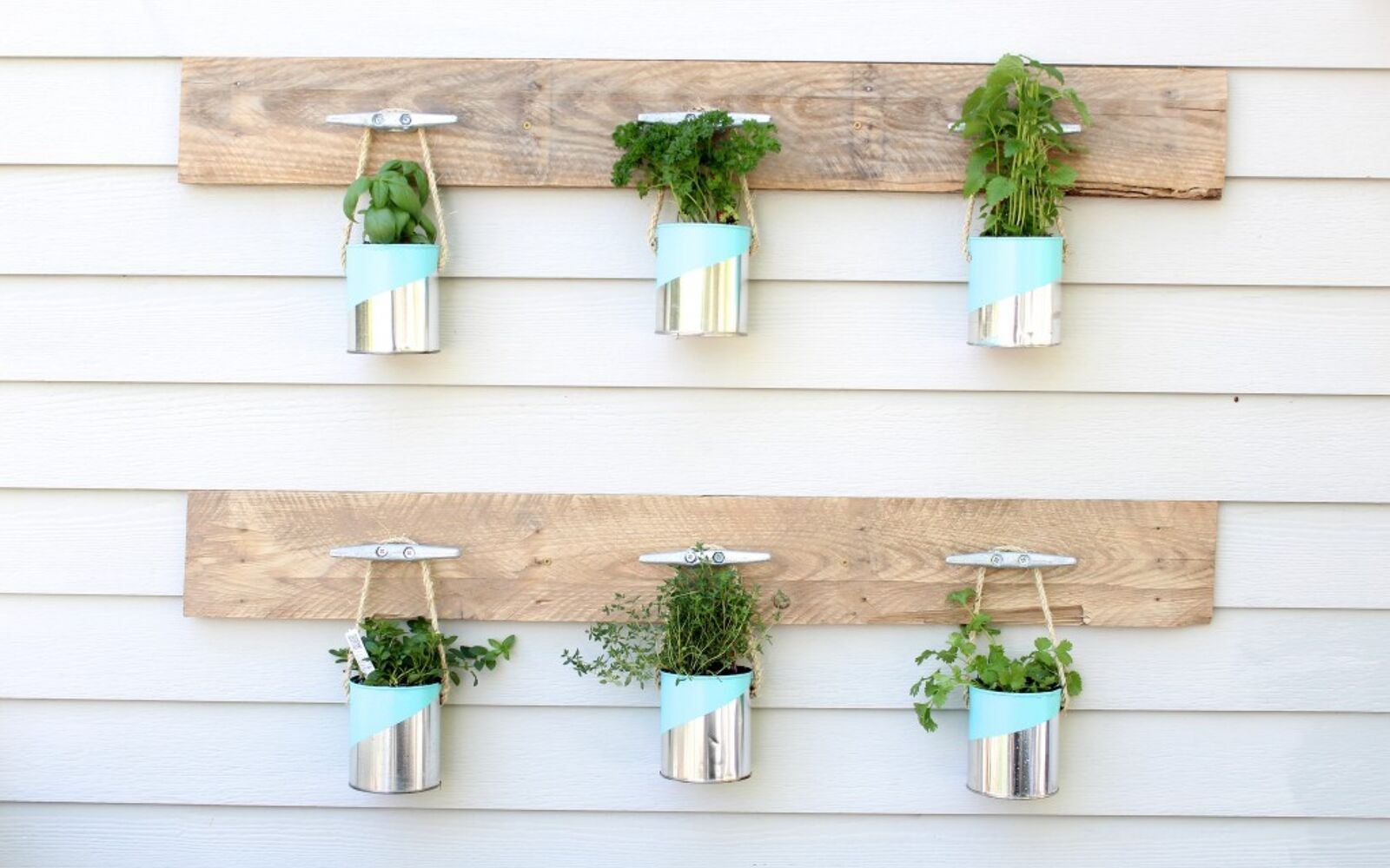 s save your old cans for these 30 home decor ideas, Use painted cans for a hanging planter