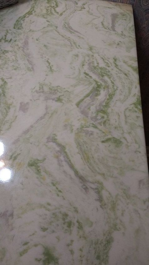 q what can i do to a cultured marble vanity top to make it more appealin
