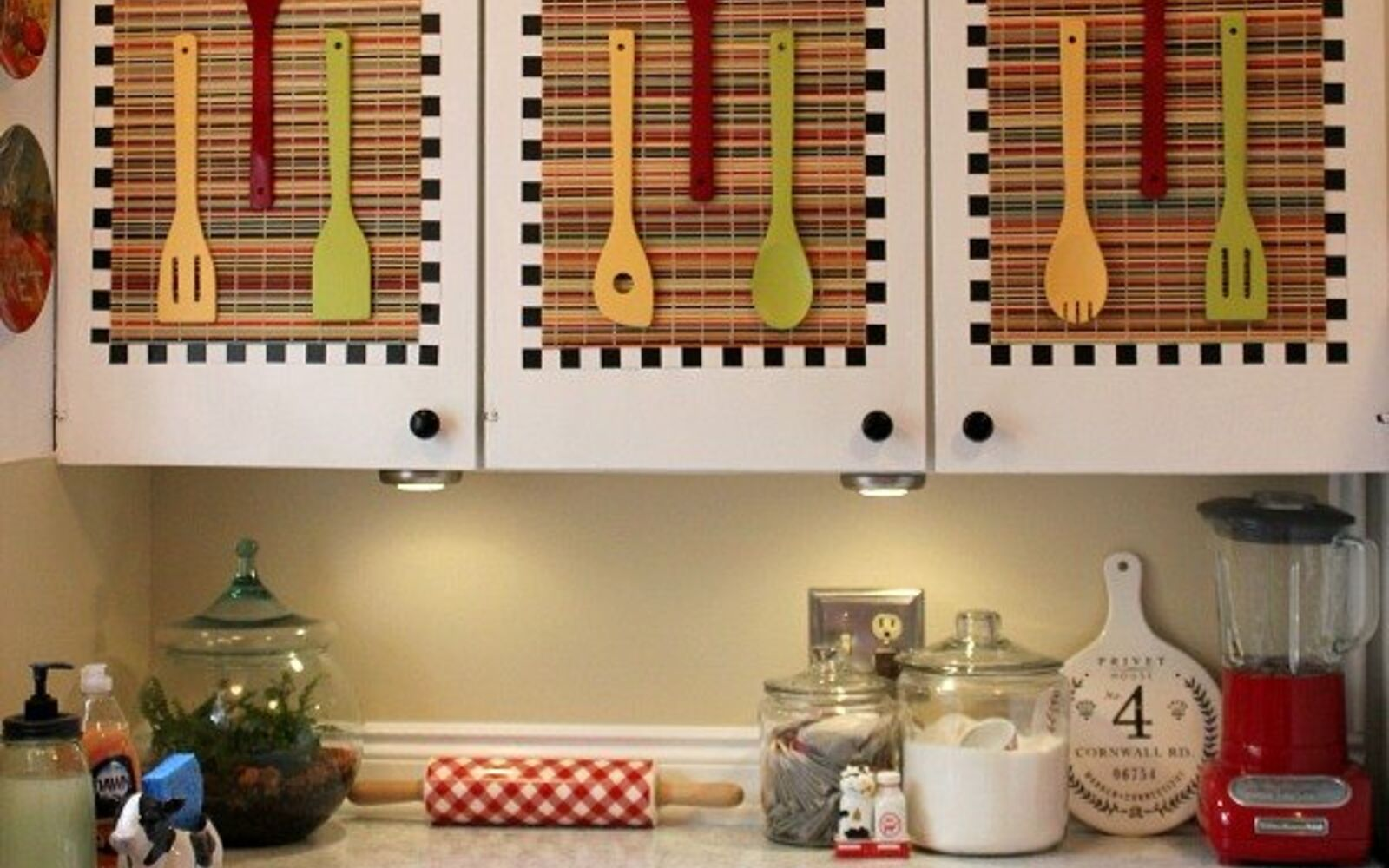 s 31 update ideas to make your kitchen look fabulous, Tack on placements and colorful utensils