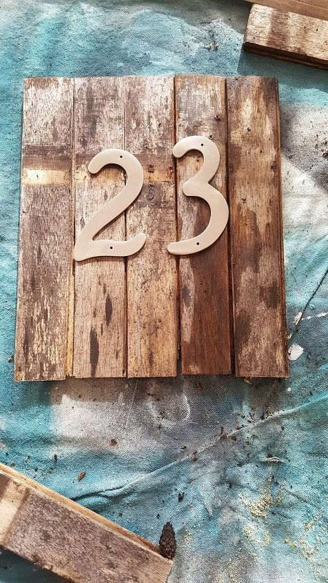 s 30 address signs that ll make your neighbors stop in admiration, Choose an old whisky barrel for a rustic look