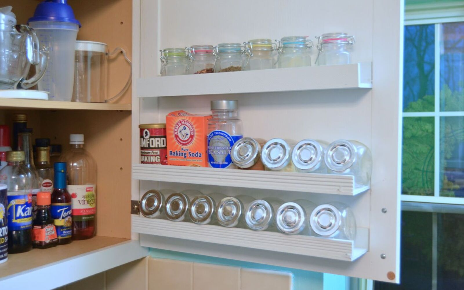 s 31 storage hacks that will instantly declutter your kitchen, Hang shelves inside a cabinet