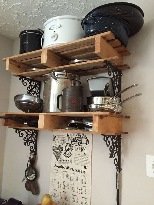s 31 storage hacks that will instantly declutter your kitchen, Pile your pots on pallets