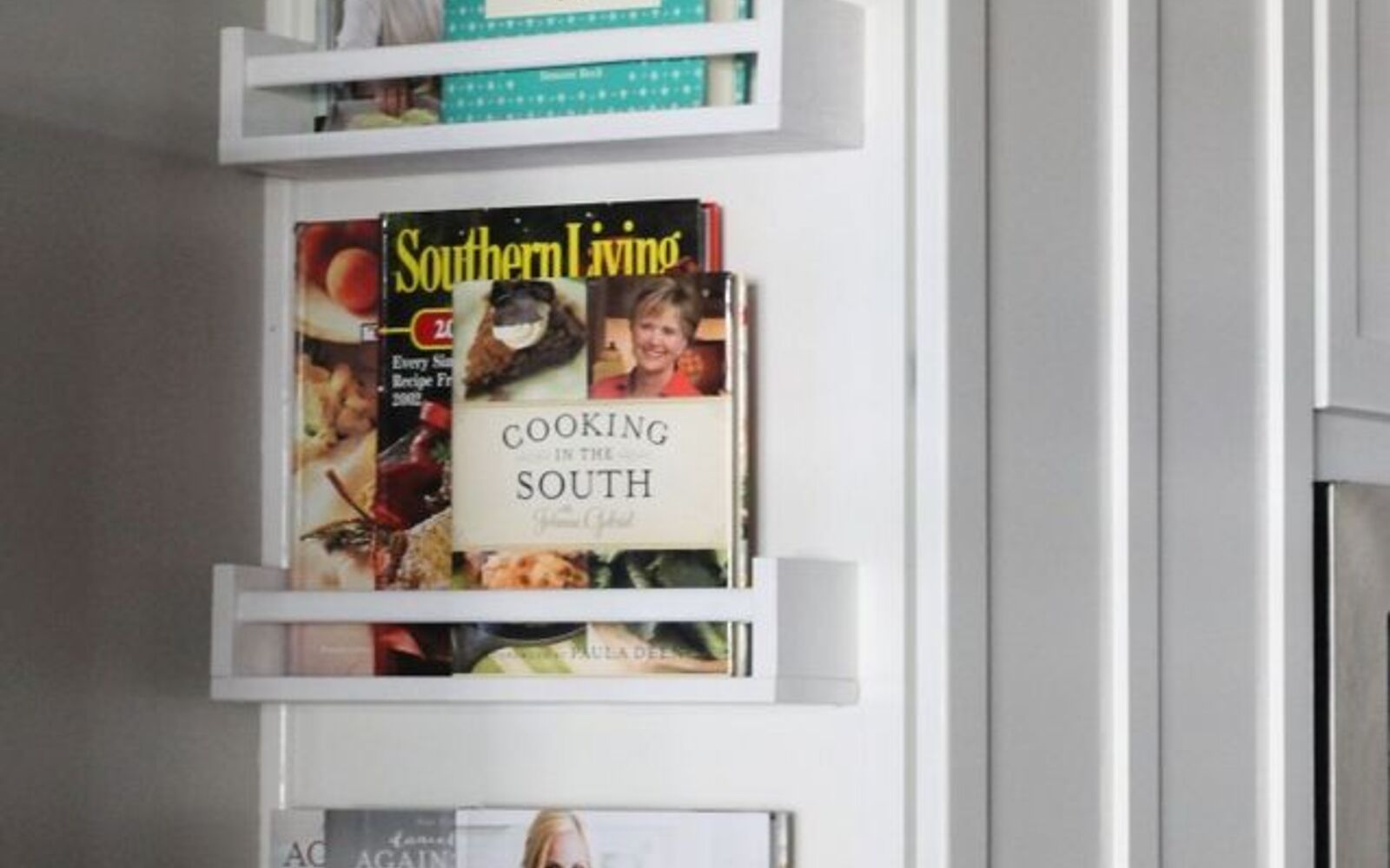 s 31 storage hacks that will instantly declutter your kitchen, Store your cookbooks at the end of a cabinet