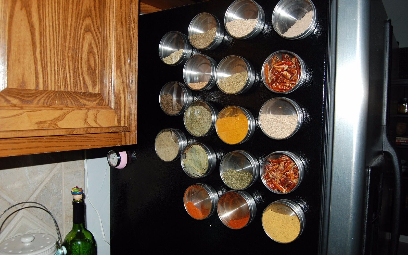 s 31 storage hacks that will instantly declutter your kitchen, Hang your spices on your fridge