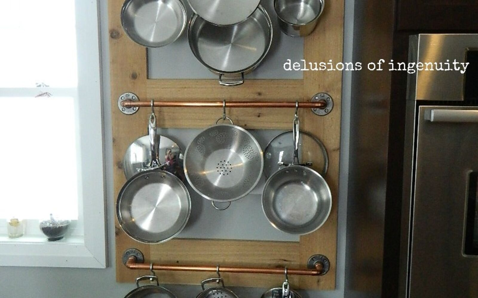 s 31 storage hacks that will instantly declutter your kitchen, Hang up your pots using crossbars and hooks