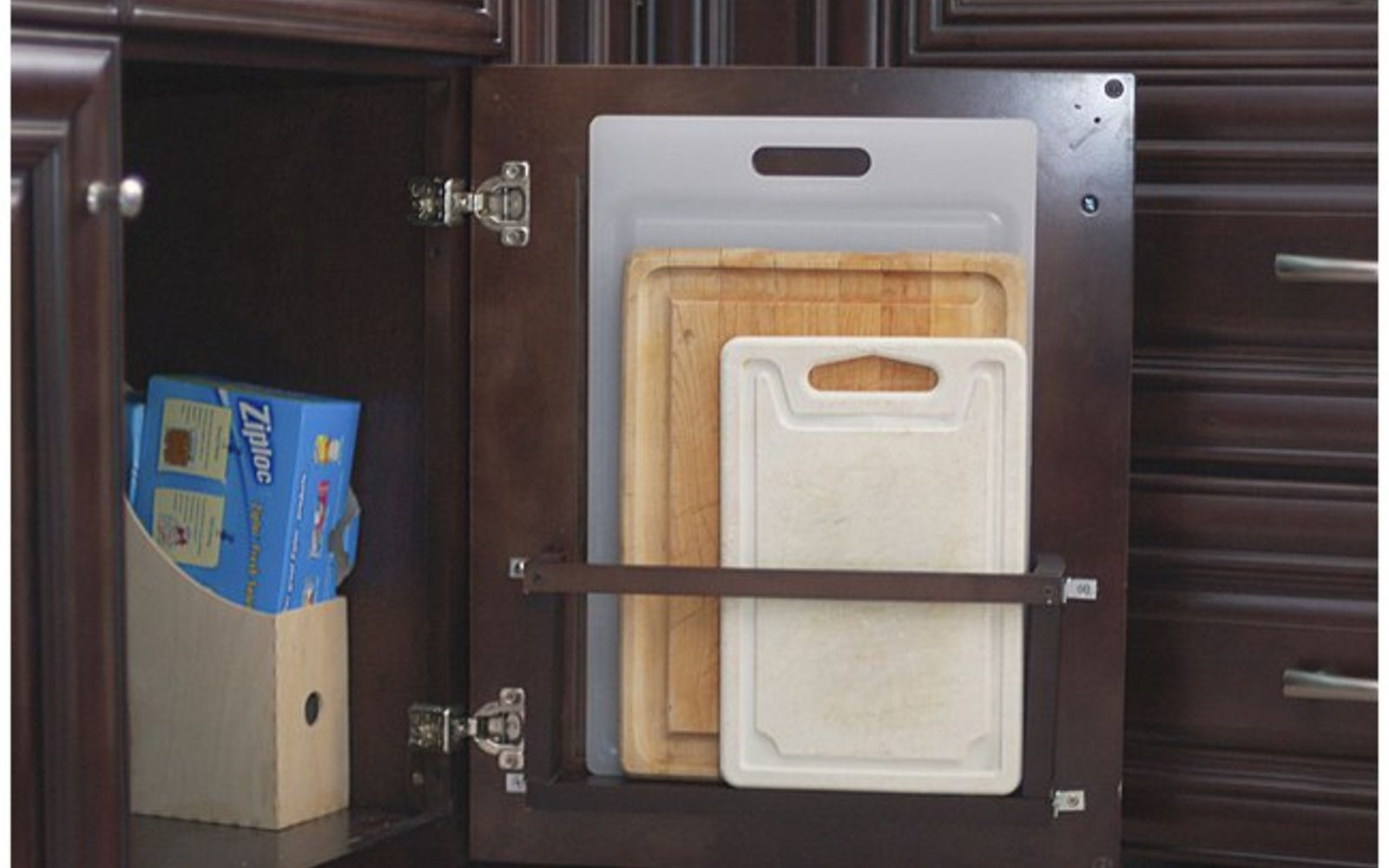 s 31 storage hacks that will instantly declutter your kitchen, Store cutting boards on your cabinet door